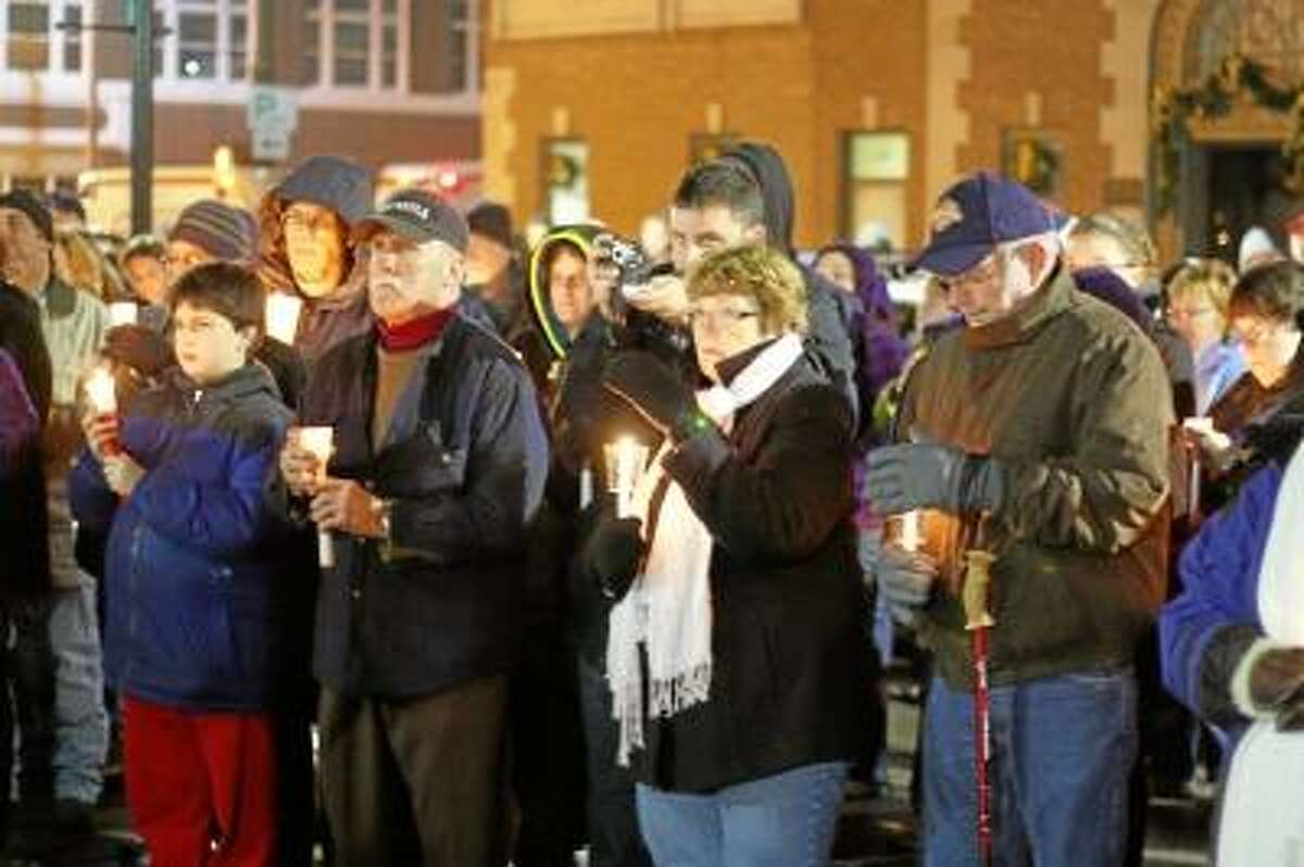 Photo by Marianne Killackey Residents gathered for a candlelight vigil at City Hall in Torrington Sunday night. The event was held to mourn the victims of the Sandy Hook Elementary School shooting and to show support to the families.