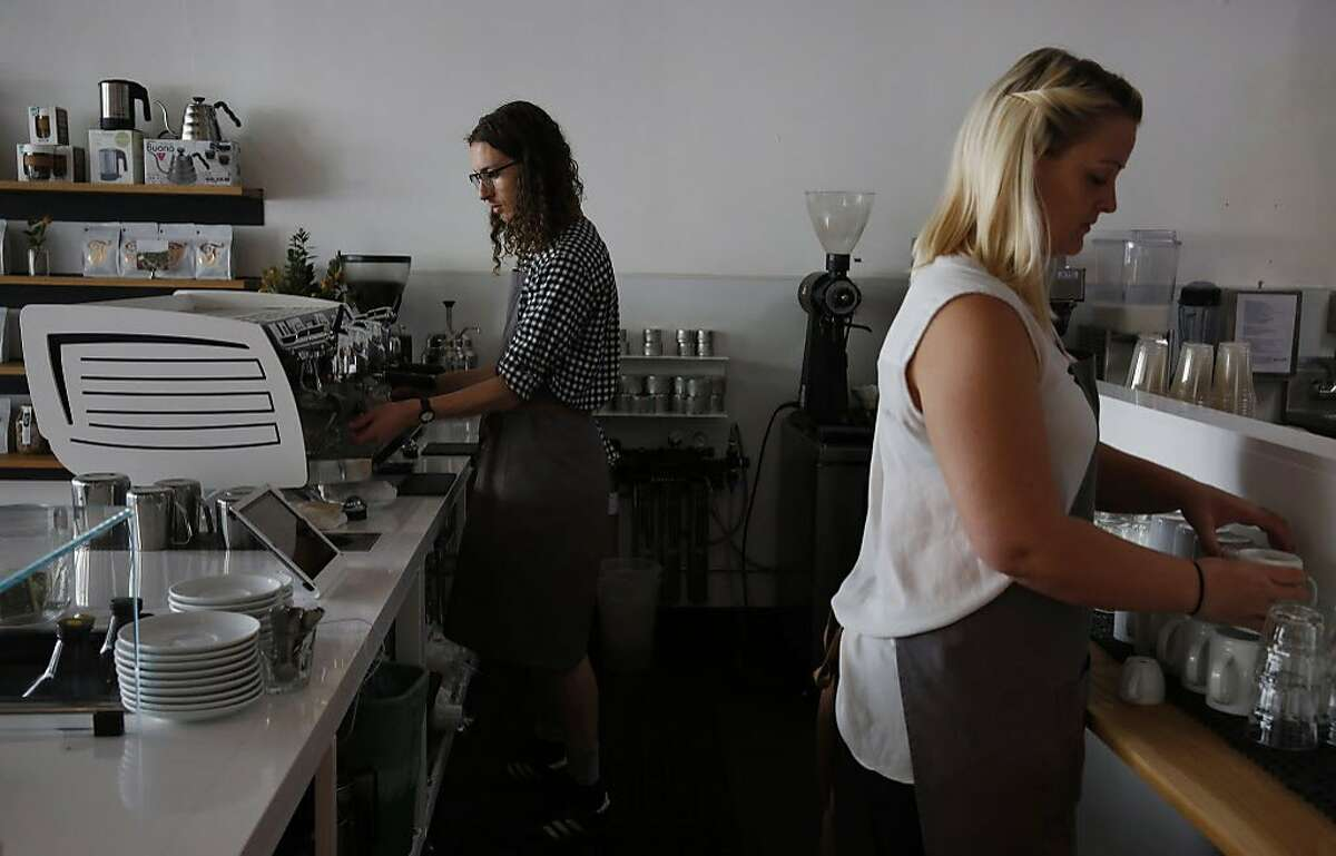 Barista Trevor Willis, left, and manager Cassandra Duft behind the counter at Saint Frank's new Mission Street cafe.