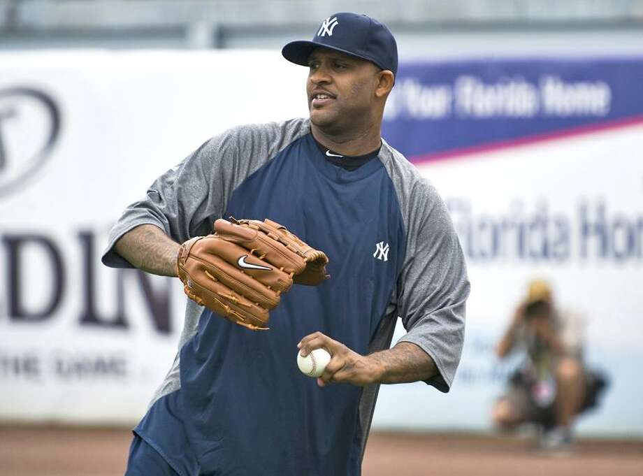 New York Yankees pitcher CC Sabathia loosens up during an informal workout after reporting for physicals at the team's spring training complex in Tampa, Florida, February 19, 2012.  REUTERS/Steve Nesius  (UNITED STATES - Tags: SPORT BASEBALL) Photo: REUTERS / X02008