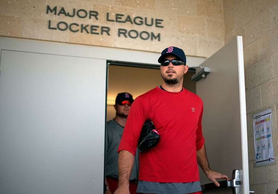 Boston Red Sox pitcher Josh Beckett exits the clubhouse for a workout as pitchers and catchers officially report to spring training baseball Sunday, Feb. 19, 2012, in Fort Myers, Fla. (AP Photo/David Goldman) Photo: AP / AP