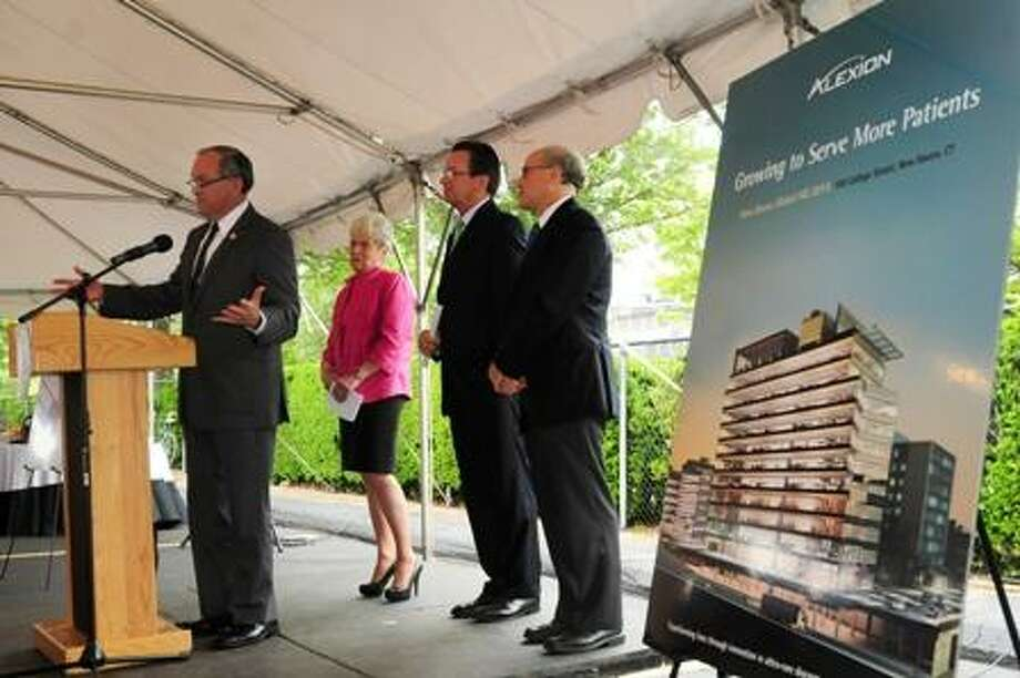 New Haven Mayor John DeStefano Jr., Lt. Gov. Nancy Wyman, Gov. Dannel P. Malloy, and Leonard Bell, of Alexion, at an announcement Tuesday that Alexion would launch a major expansion into New Haven's Downtown Crossing project by Carter Winstanley at 100 College St.
