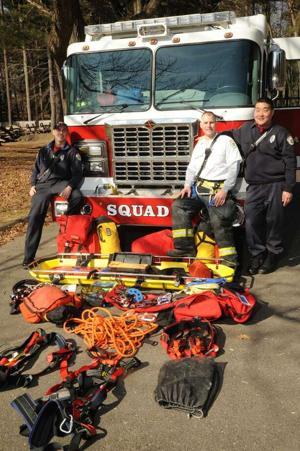 Dan Such, Fire Capt Ed Evers (white shirt) and Nelson Hwang of the Hamden Fire Departments Squad 1 mountain rescue pose with mountain rescue gear at Sleeping Giant State Park Friday, Februaty 10, 2012. vmWilliams/Register