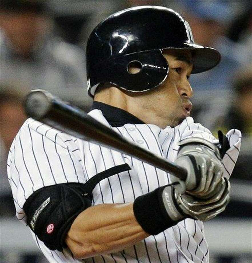 FILE - In this Sept. 20, 2012, file photo, New York Yankees' Ichiro Suzuki hits a fourth-inning two-RBI double against the Toronto Blue Jays during a baseball game at Yankee Stadium in New York. Suzuki and the Yankees are closing in on a contract that would guarantee the outfielder between $12 million and $13 million. A person familiar with the negotiations, speaking on condition of anonymity because talks were ongoing, said Thursday, Dec. 13, 2012, the agreement likely would be for a two-year deal. (AP Photo/Kathy Willens, File) Photo: AP / AP