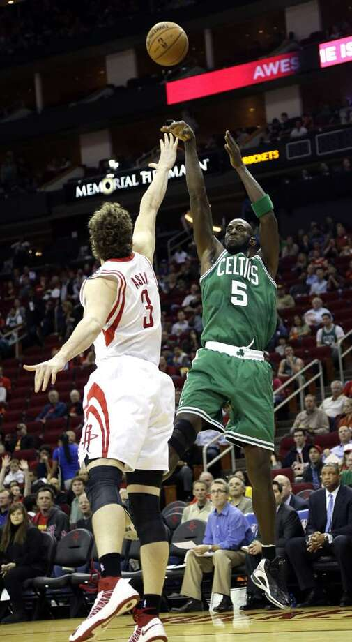 Boston Celtics' Kevin Garnett (5) shoots over Houston Rockets' Omer Asik (3) during the first quarter of an NBA basketball game Friday, Dec. 14, 2012, in Houston. (AP Photo/David J. Phillip) Photo: AP / AP2012
