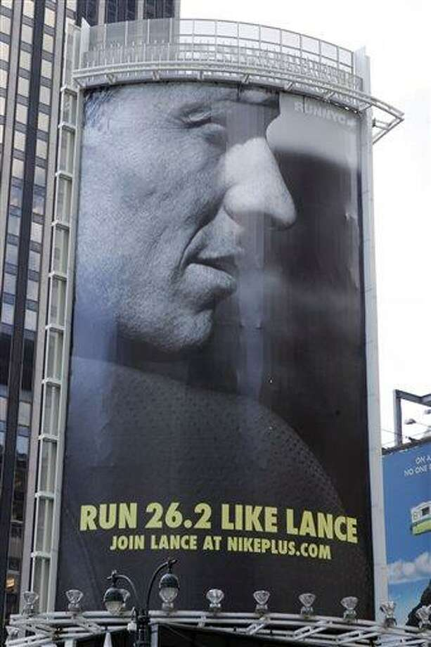 "In an 80-foot billboard at 34th Street and 7th Avenue in Manhattan, Lance Armstrong and Nike challenge New Yorkers to ""Run Like Lance"" in a 2006 file photo. Nike said Wednesday that it is severing ties with Armstrong, citing insurmountable evidence that the cyclist participated in doping and misled the company for more than a decade. Associated Press Photo: AP / NIKE via PR NewsFoto"