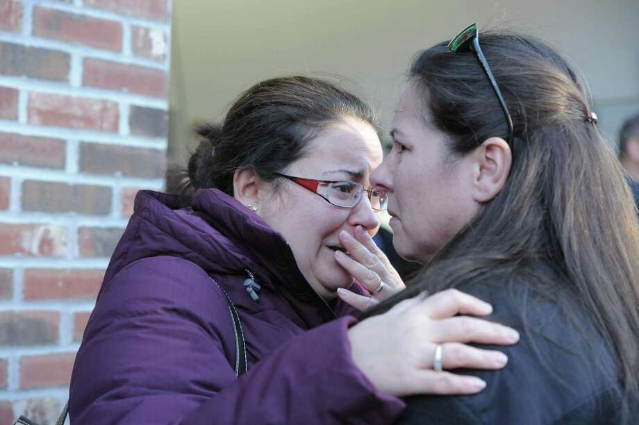(Photo by Laurie Gaboardi/Litchfield County Times) Parents at the scene of the Newtown school shooting Friday morning.