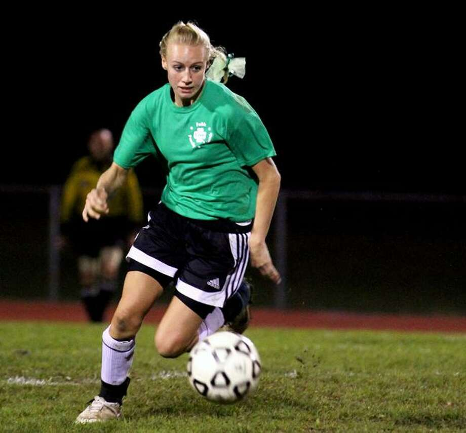 Marianne Killackey/Special to the Register Citizen Sophomore forward Paige Middleton looks to pass in her team's game against Naugatuck Wednesday night at the Robert H. Frost Sports Complex at Torrington High School. / 2012