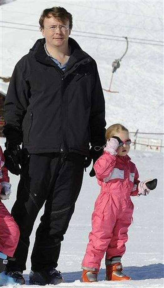 """In this 2011 file photo, Netherland's Prince Friso, left, and his daughter, Zaria, right, pose for photographers during a photo session in the Austrian skiing resort of Lech. Queen Beatrix's second son  has been seriously injured in an avalanche and his """"life remains at risk"""" after being hospitalized, a Netherlands spokesman says. The government says Prince Friso was buried today by an avalanche in the ski resort of Lech and has been admitted to an Innsbruck hospital. A statement said he is in the intensive care unit.  Associated Press Photo: AP / AP"""
