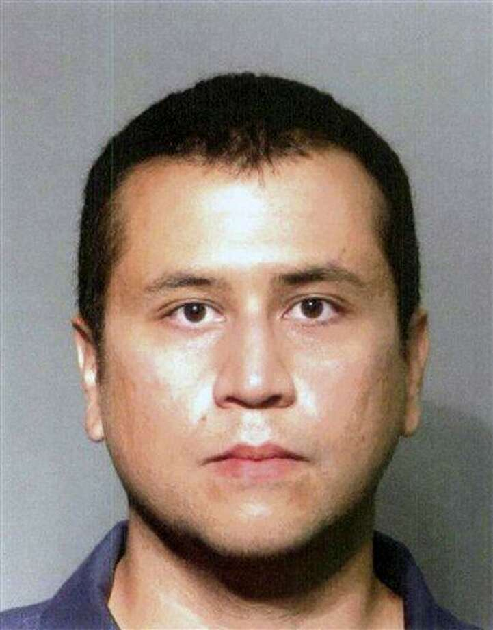 This file booking photo provided by the Seminole County Sheriff's Office shows George Zimmerman. The former neighborhood watch volunteer who killed Trayvon Martin told his wife to buy bulletproof vests for them and for his attorney, according to jailhouse calls released Monday. Associated Press Photo: AP / Seminole County Sheriff's Office