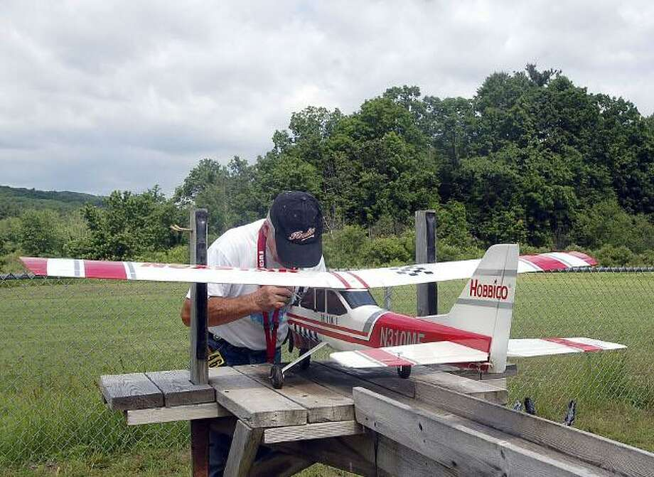 Photo by Johnny Burnham A member of the Nutmeg Flyers works on a plane during the Buddy Box event June 10.