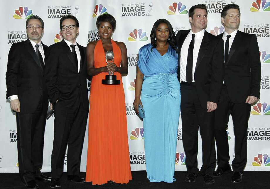 "Viola Davis, third from left, and Octavia Spencer, third from right, joined by the crew of ""The Help,"" pose backstage with the award for outstanding motion picture at the 43rd NAACP Image Awards on Friday, Feb. 17, 2012, in Los Angeles. (AP Photo/Matt Sayles) Photo: AP / AP"