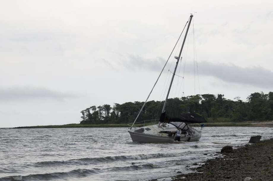 A small engine boat was totaled after its keel was ripped off while being towed off the sandbar at Silver Sands State Park. The boat operator sustained minor scrape injuries to his legs. (Rich Scinto)