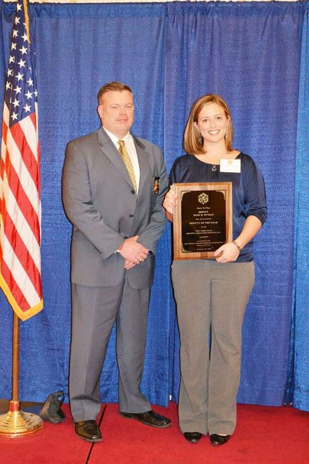 Oneida County Sheriff Robert Maciol and Lauren Wyman, widow of Deputy Kurt Wyman, accept the Deputy of the Year Award on behalf of Wyman.