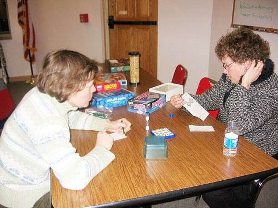 Photo Courtesy HAMILTON PUBLIC LIBRARY Margaret Wehrer, left, and Georgia Frank attended last year's Family Board Game Night. This year's event will be Thursday, Feb. 23 at the Hamilton Public Library Community Room from 6-7:30 p.m. Families are welcome to bring their favorite games.