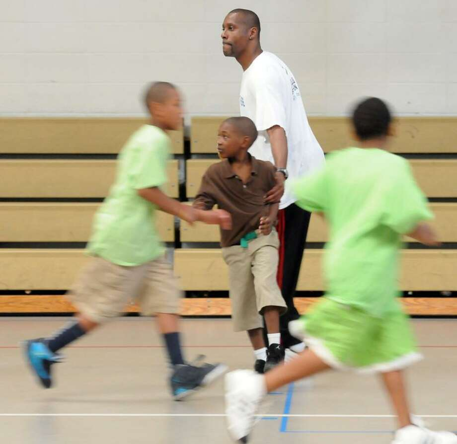 Tharon Mayes, 1982 graduate of Lee High School in New Haven returned three years ago to New Haven to work at the Boys & Girls Club. Mara Lavitt/New Haven Register8/15/12