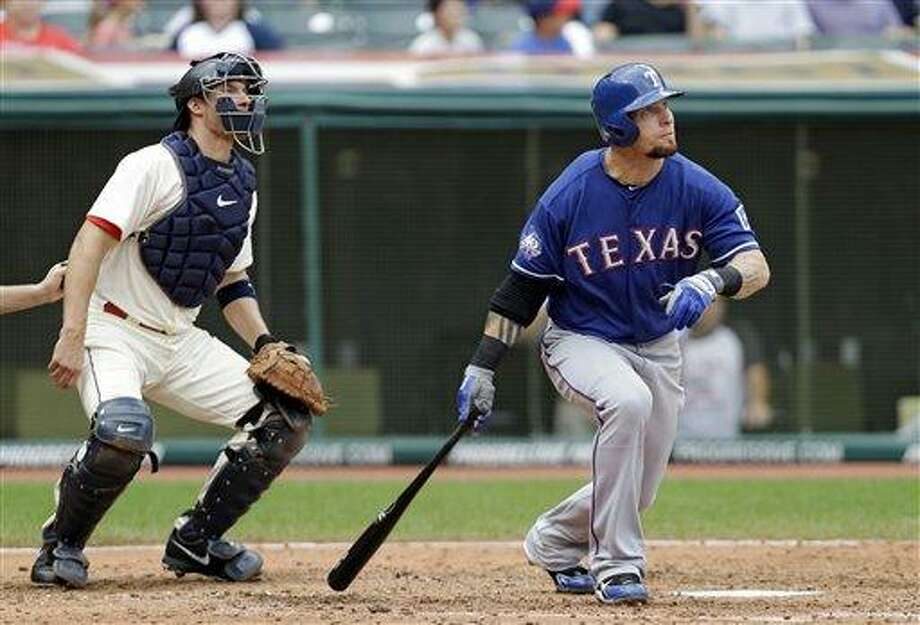 FILE - In this Dec. 2, 2012, file photo, Texas Rangers' Josh Hamilton watches his home run with Cleveland Indians catcher Lou Marson during a baseball game in Cleveland. Rangers general manager Jon Daniels said Thursday, Dec. 13, 2012, that Hamilton has agreed to a contract with the Los Angeles Angels. (AP Photo/Mark Duncan, File) Photo: AP / AP