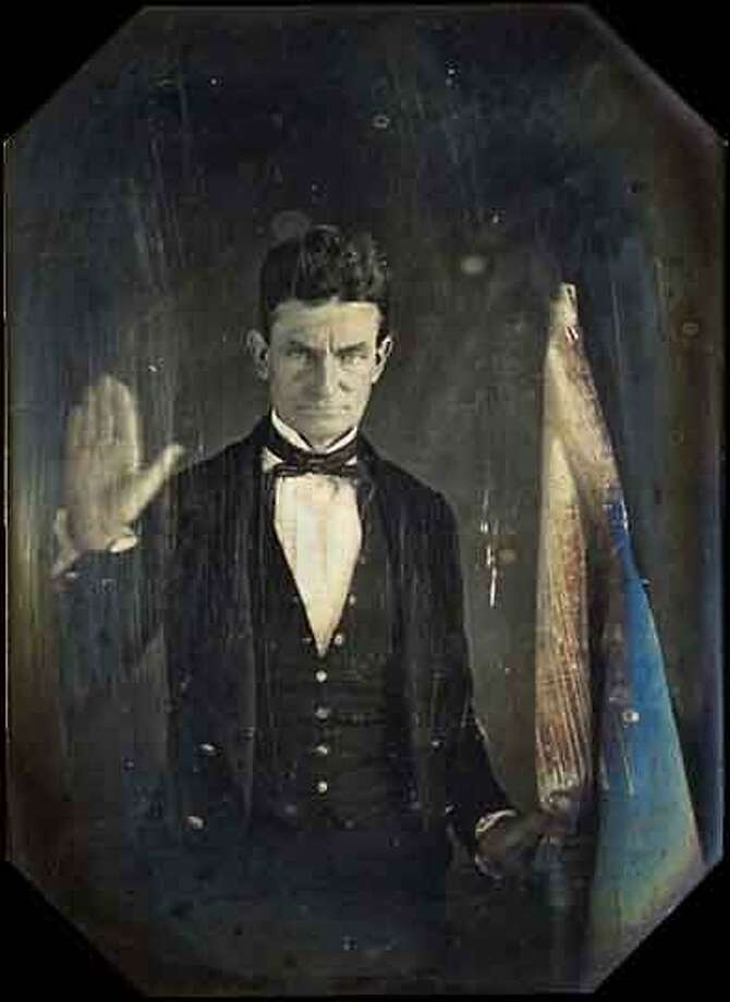 John Brown in 1846 in Springfield, Massachusetts, holding the flag of Subterranean Pass Way, his militant counterpart to the Underground Railroad.