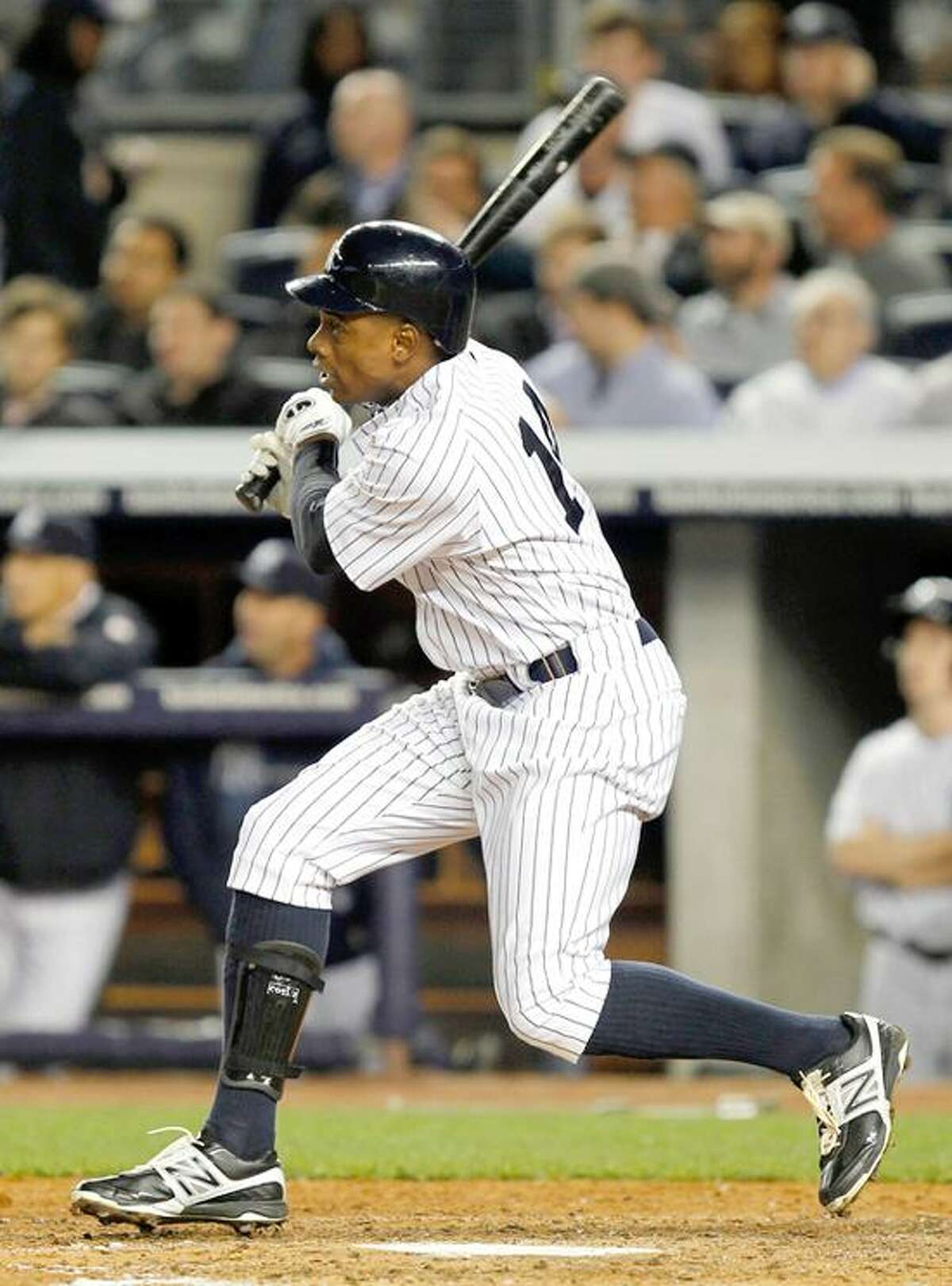 Apr 19, 2012; Bronx, NY, USA; New York Yankees center fielder Curtis Granderson hits a home run in the fourth inning against the Minnesota Twins at Yankee Stadium. Mandatory Credit: Tim Farrell/THE STAR-LEDGER via US PRESSWIRE
