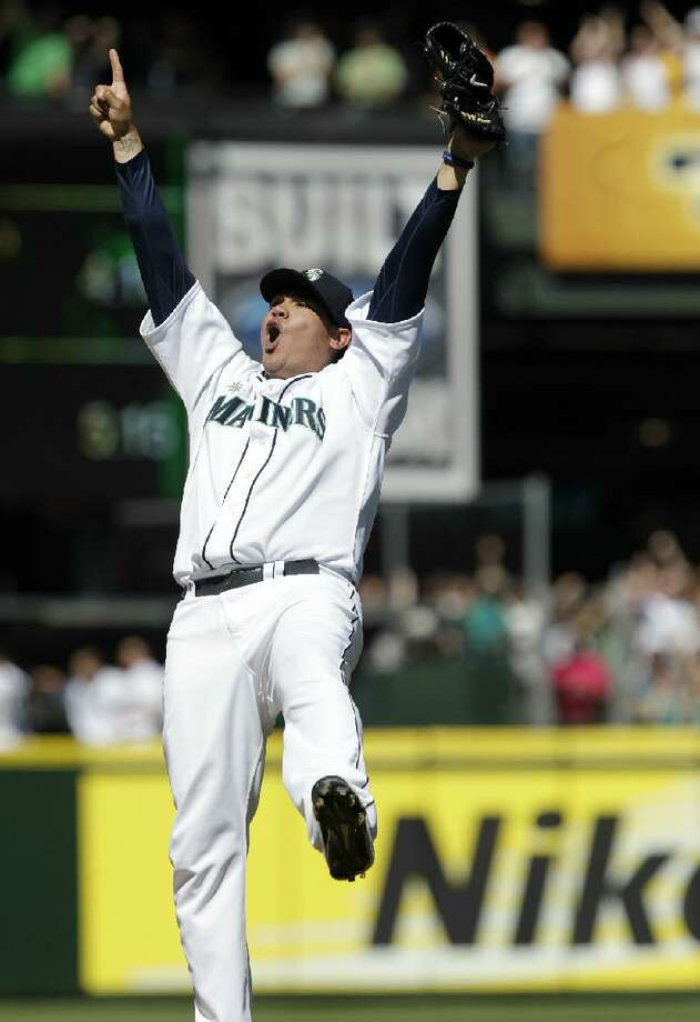 ASSOCIATED PRESS Seattle Mariners pitcher Felix Hernandez reacts after throwing a perfect game against the Tampa Bay Rays Wednesday in Seattle. The Mariners won 1-0.