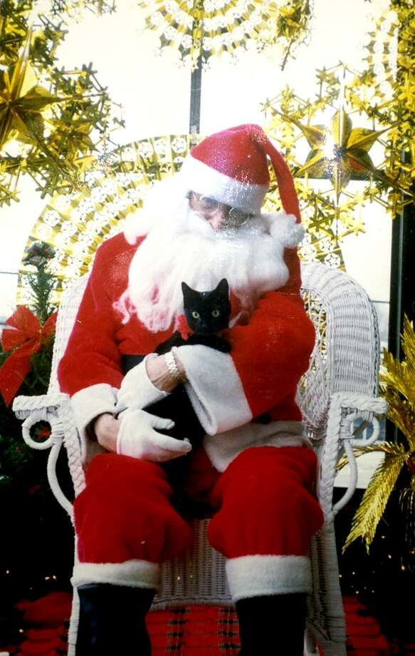 Contributed photo: Maggie was all cute and cuddly for the camera, but shortly after this photo was taken, she tried to climb Santa's beard.