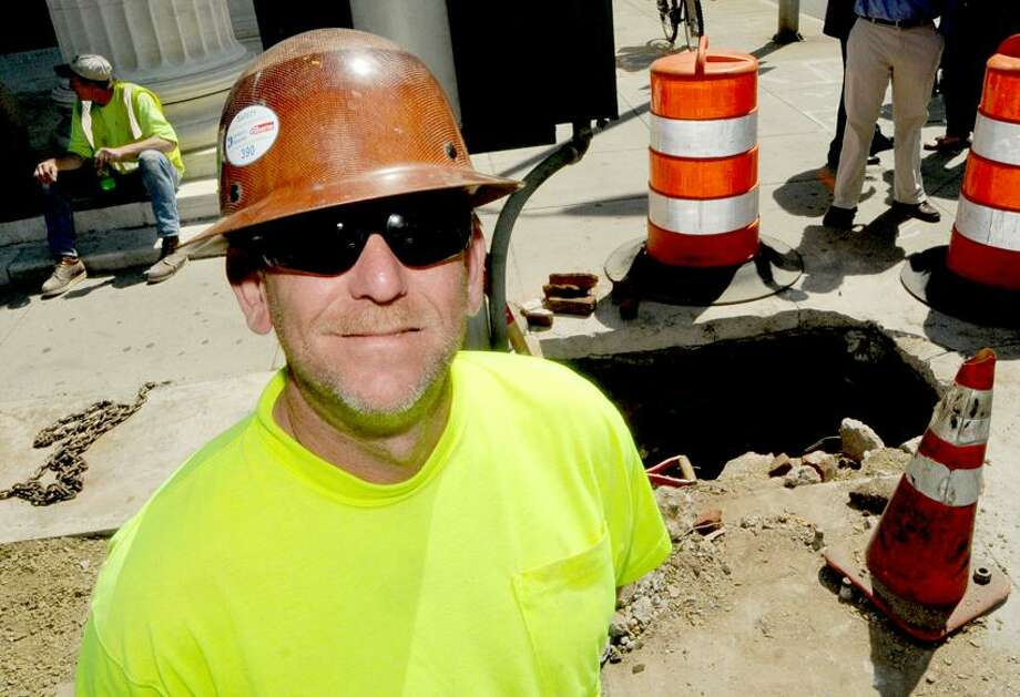 Dan Aiken, forman electrician of Rizzo Electrical of Danbury, found the underground cistern on the corner of Church Street and Crown Street. Peter Hvizdak/New Haven Register