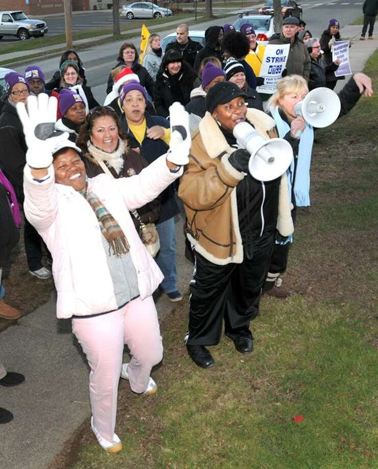 Striking West River Health Care Center workers jeer and cheer as they protest in front of the nursing and rehabilitation center in Milford Thursday,  December 13, 2012.   Photo by Peter Hvizdak / New Haven Register Photo: New Haven Register / ©Peter Hvizdak /  New Haven Register