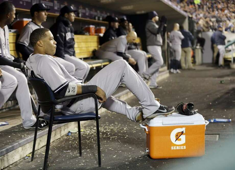 New York Yankees' Robinson Cano watches as the Yankees bat in the third inning of Game 3 of the American League championship series against the Detroit Tigers Tuesday, Oct. 16, 2012, in Detroit. (AP Photo/Paul Sancya ) Photo: AP / AP2012
