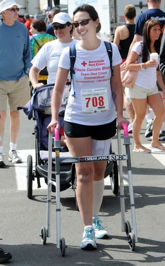 Colleen Kelly Alexander of Clinton takes part in the 32nd Annual Branford Road Race on Sunday. Mara Lavitt/New Haven Register