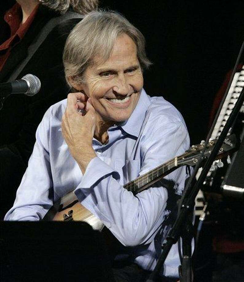 "FILE - In this Dec. 3, 2007 file photo, musician Levon Helm appears on the new ""Imus in the Morning"" program at New York. Helm, who was in the final stages of his battle with cancer, died Thursday, April 19, 2012 in New York.  He was 71.  He was a key member of The Band and lent his distinctive Southern voice to classics like ""The Weight"" and ""The Night They Drove Old Dixie Down."" (AP Photo/Richard Drew, file) Photo: AP / AP2007"