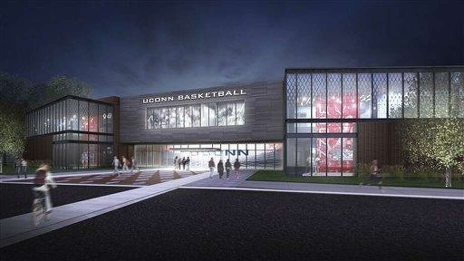 This image released Tuesday, Oct. 16, 2012 by the University of Connecticut shows a rendering of a proposed UConn Basketball Development Center to be built on the campus in Storrs, Conn. With donations and pledges in hand for $24 million of the $32 million cost to build the center, the project is expected to take about two years to complete.  (AP Photo/University of Connecticut) Photo: AP / University of Connecticut