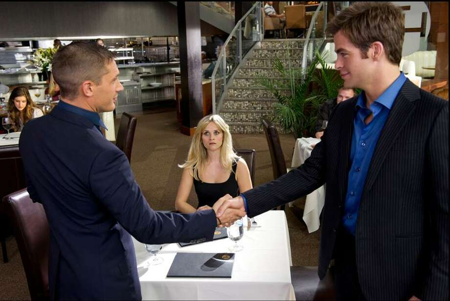 """Kimberley French/20th Century Fox photo: Two spies, Tom Hardy, left, and Chris Pine, have their eye on the same woman, Reese Witherspoon, in """"This Means War."""" Photo: AP / TM and © 2012 Twentieth Century Fox Film Corporation. All rights reserved. Not for sale or duplication."""