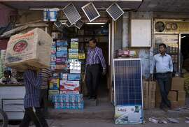 In this Oct. 1, 2015 photo, solar panels are displayed for sale at a market in New Delhi, India. India plans a fivefold boost in renewable energy capacity in the next five years to 175 gigawatts, including solar power, wind, biomass and small hydropower dams. (AP Photo/Saurabh Das)