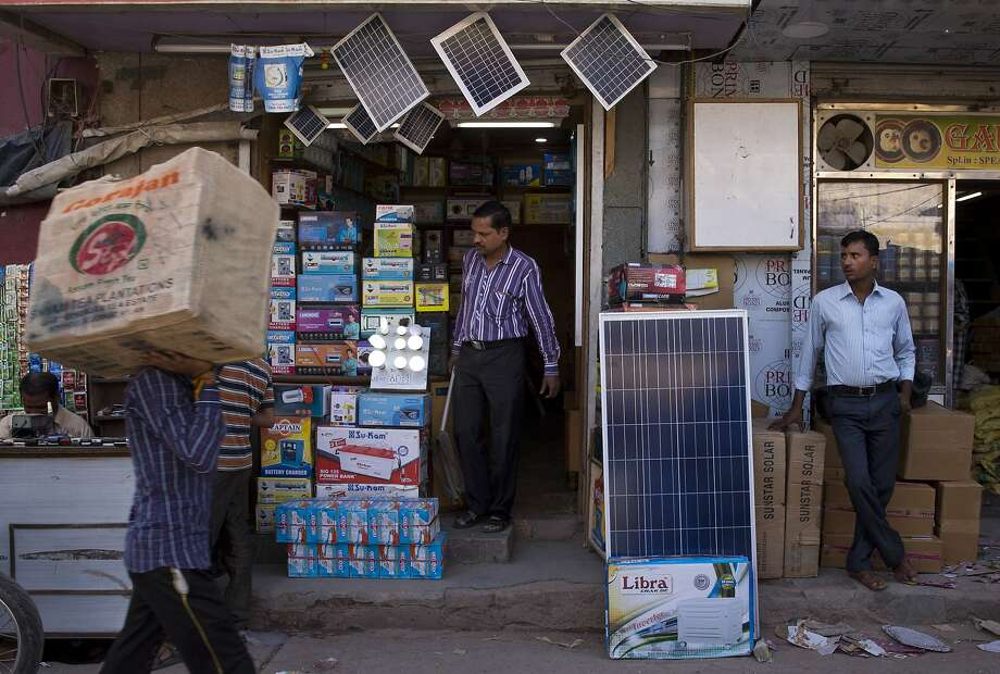 India is moving to boost the energy it gets from renewable resources to 40 percent by 2030, including an expansion of solar power, like the solar panels sold at a New Delhi market. Photo: Saurabh Das, Associated Press