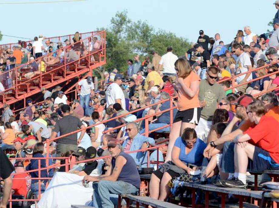 Dispatch Staff Photo by DAVID M. JOHNSON Fans at Utica-Rome Speedway wait for the main event to start on Sunday, June 17, 2012 in Vernon.