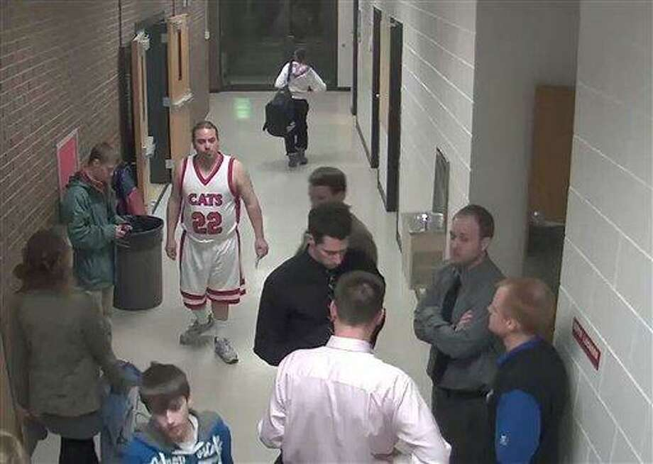 "Security camera footage provided by Bismarck Schools, shows Sherwin Shayegan, 28, of Bothell, Wash., dressed in a basketball uniform in a hallway at Century High School in Bismarck, N.D. Dubbed the ""Piggyback Bandit,"" Shayegan crashed school sporting events in at least five states from Washington to Minnesota, in some cases coaxing players to give him a piggyback ride. Associated Press Photo: AP / Bismarck Schools"