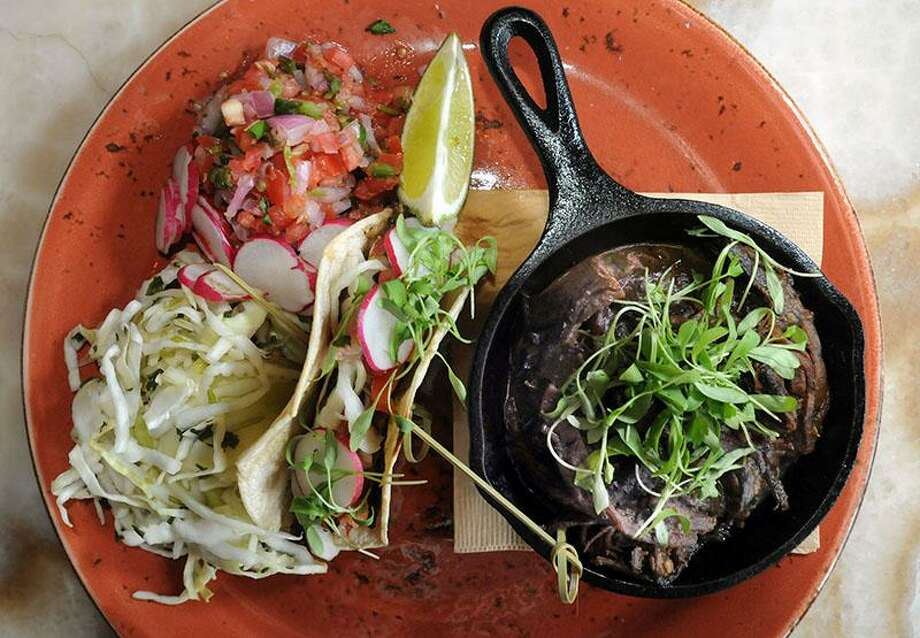The gluten-free, South Dakota smoked buffalo brisket tacos with cilantro-cabbage, radish and lime, with Hatch green chile sauce. Geronimo Restaurant, New Haven.  Mara Lavitt/New Haven Register11/29/12