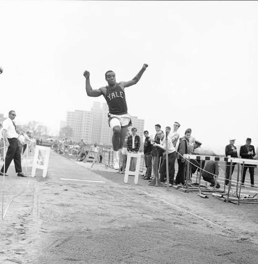 Yale's Calvin Hill competes in the broad jump event during the Queens-Iona Relays on Randall's Island in New York, April 22, 1967.(AP Photo) Photo: AP / AP1967
