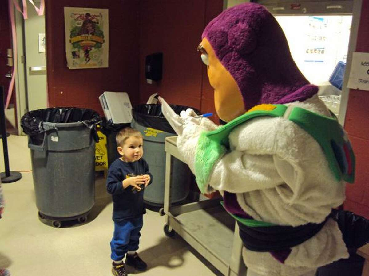 RICKY CAMPBELL/ Register Citizen Ryan, 3, waits for Buzz Lightyear's signature Wednesday at the Disney Breakfast for Dinner. The family event, sponsored by Litchfield's A-OK Club, used the proceeds to benefit the Make-A-Wish Foundation.