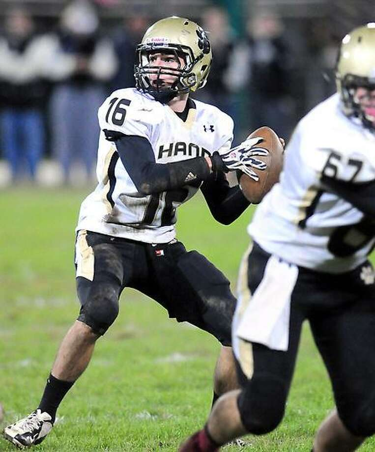 Daniel Hand quarterback Brendan Bilcheck looks to pass in the second half against Xavier at Palmer Field in Middletown on 10/12/2012. Photo by Arnold Gold/New Haven Register