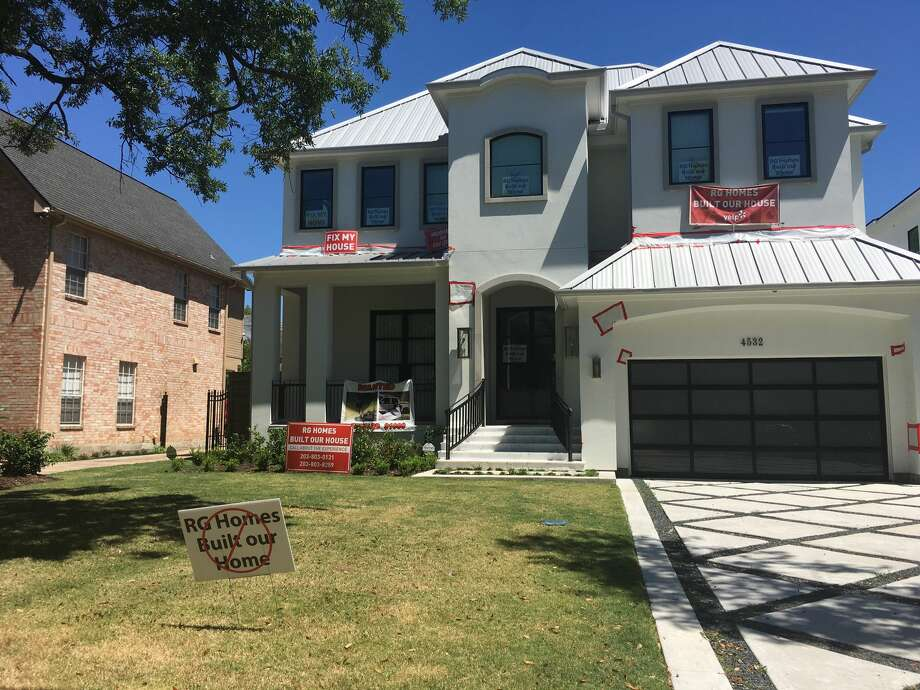 Custom homebuilder Roy Gabbay has been charged with tampering with a government document in relation to a luxury home under construction in Bellaire. Upset homeowners in the neighborhood have responded with yard signs, pictured Thursday, Aug. 27, 2017. Photo: Melissa Aguilar   Houston Chronicle