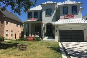 Custom homebuilder Roy Gabbay has been charged with tampering with a government document in relation to a luxury home under construction in Bellaire. Upset homeowners in the neighborhood have responded with yard signs, pictured Thursday, Aug. 27, 2017.