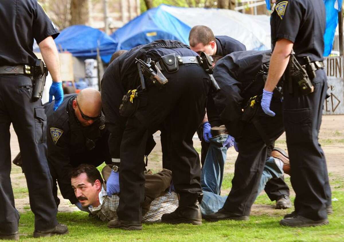 New Haven police break up Occupy New Haven's camp on the Green. Thirteen people were arrested including Sean Conlon. Melanie Stengel/Register