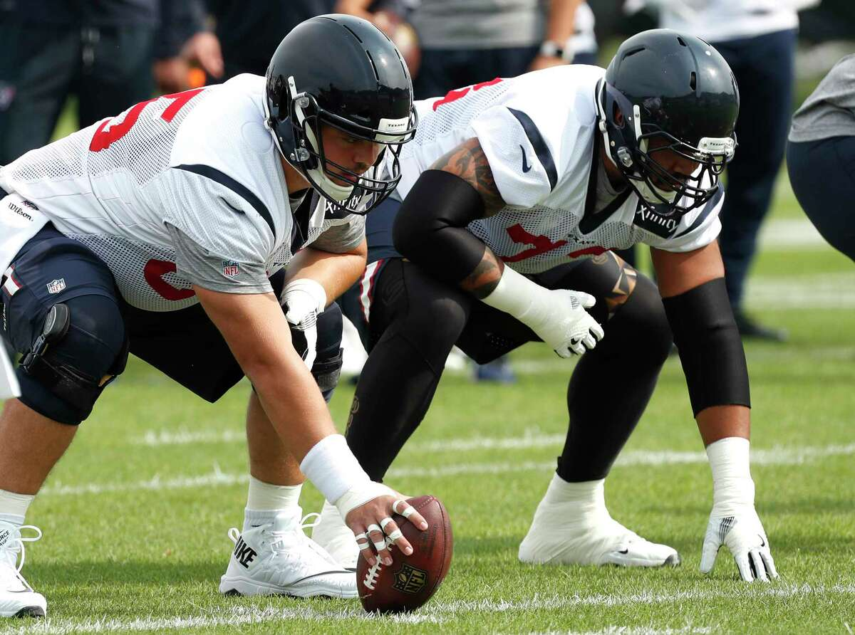 Houston Texans center Greg Mancz (65) lines up on the ball with guard Josh Walker (73) during training camp at the Greenbrier on Thursday, July 27, 2017, in White Sulphur Springs, W.Va.