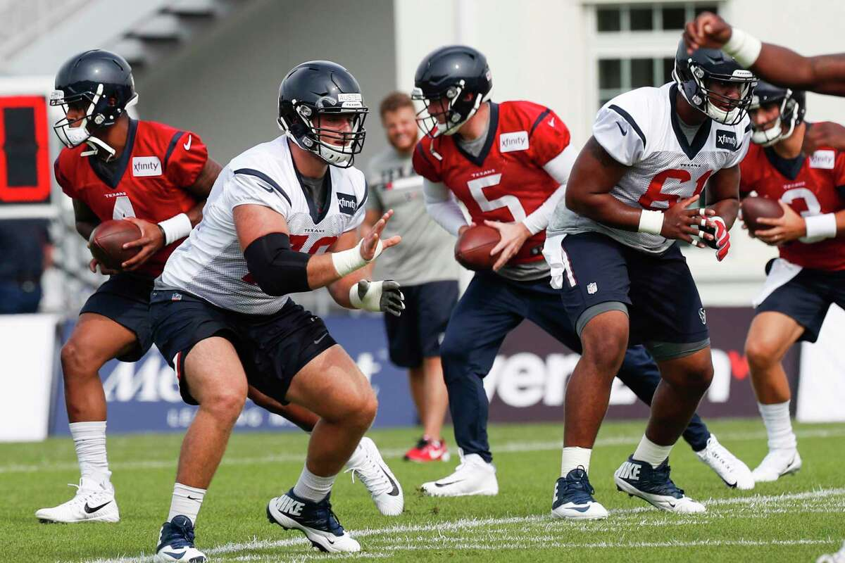 Houston Texans quarterbacks Deshaun Watson (4), Brandon Weeden (5) and Tom Savage (3) drop back to run a handoff drill behind Houston Texans centers Erik Austell (78) and Kyle Fuller (61) during training camp at the Greenbrier on Thursday, July 27, 2017, in White Sulphur Springs, W.Va.