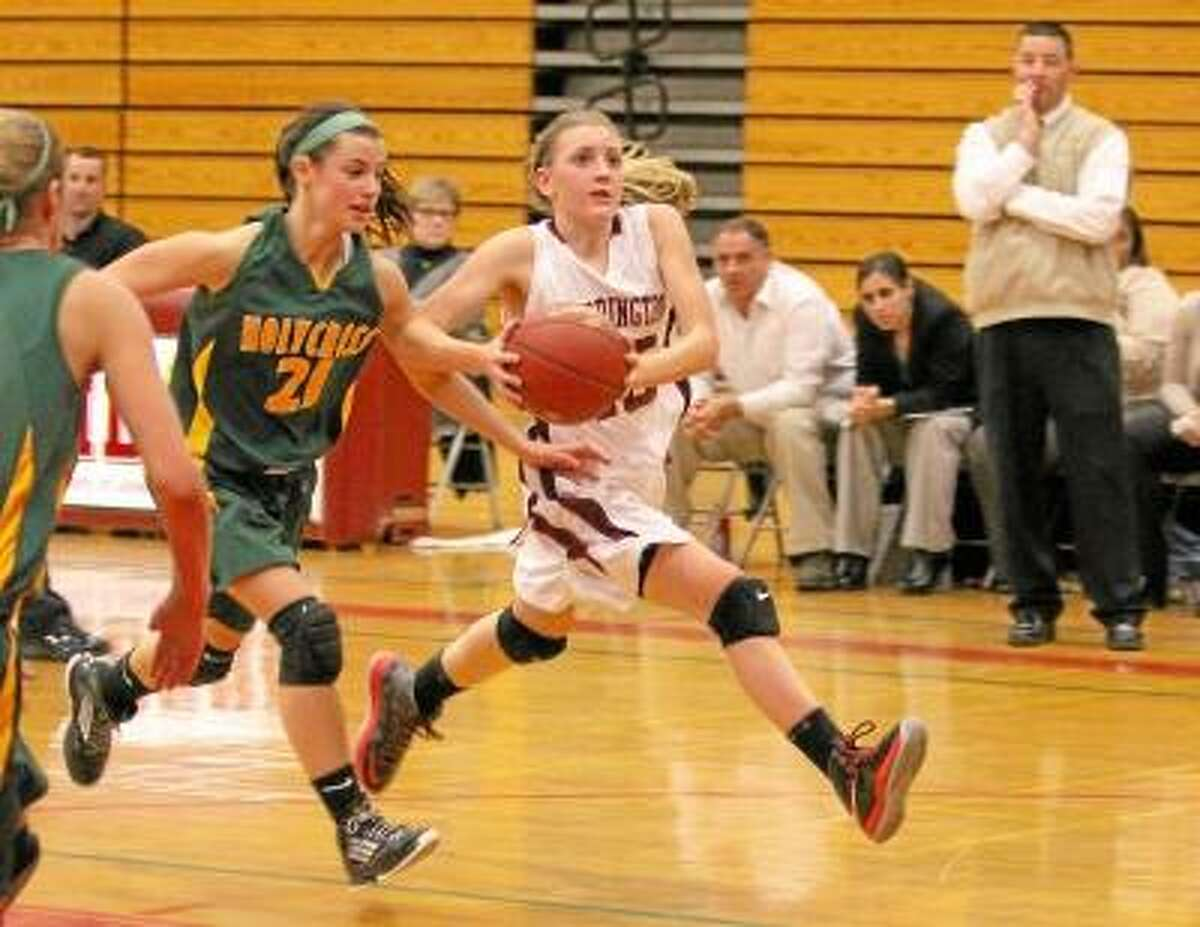Torrington's Caroline Teti dribbles down the court after getting a steal. Photo by Marianne Killackey/Special to Register Citizen