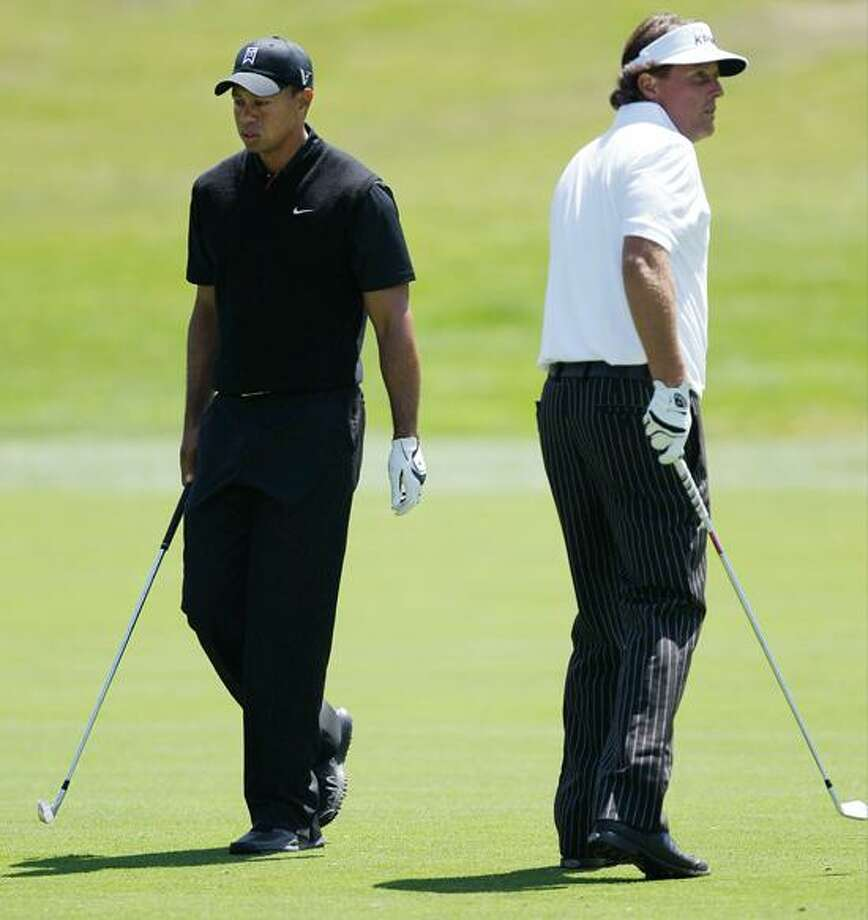 Tiger Woods and Phil Mickelson play the fourth hole during the second round of the U.S. Open Championship golf tournament Friday, June 15, 2012, at The Olympic Club in San Francisco. (AP Photo/Ben Margot) Photo: AP / AP2012