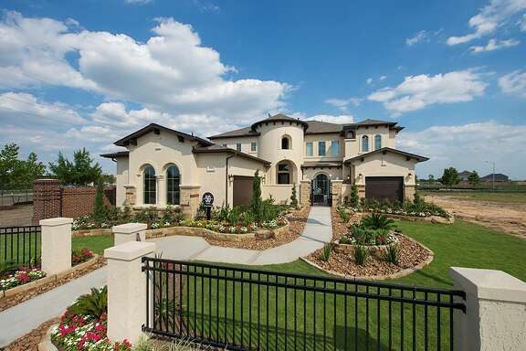 Perry Homes' new Valenica model, its second in Aliana, has a gated courtyard and optional spice kitchen, prayer room and media room.