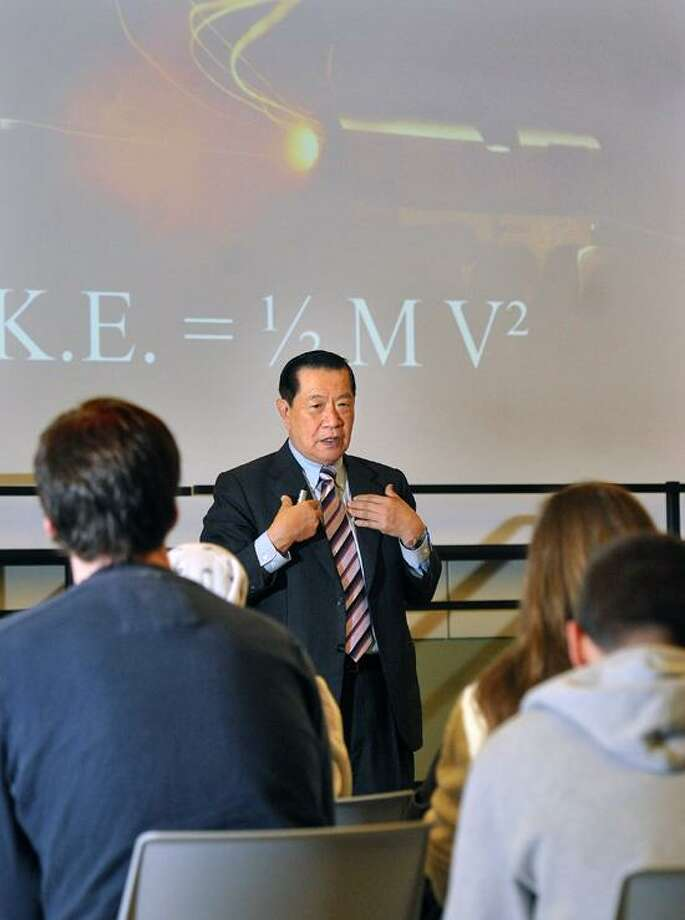 """Dr. Henry Lee speaks to students and visitors at Gateway Community College about his work and teen gun violence. The title of the talk was; """"Oil and Water Do Not Mix and Handguns and Teenagers Do Not Mix.""""  Peter Casolino"""