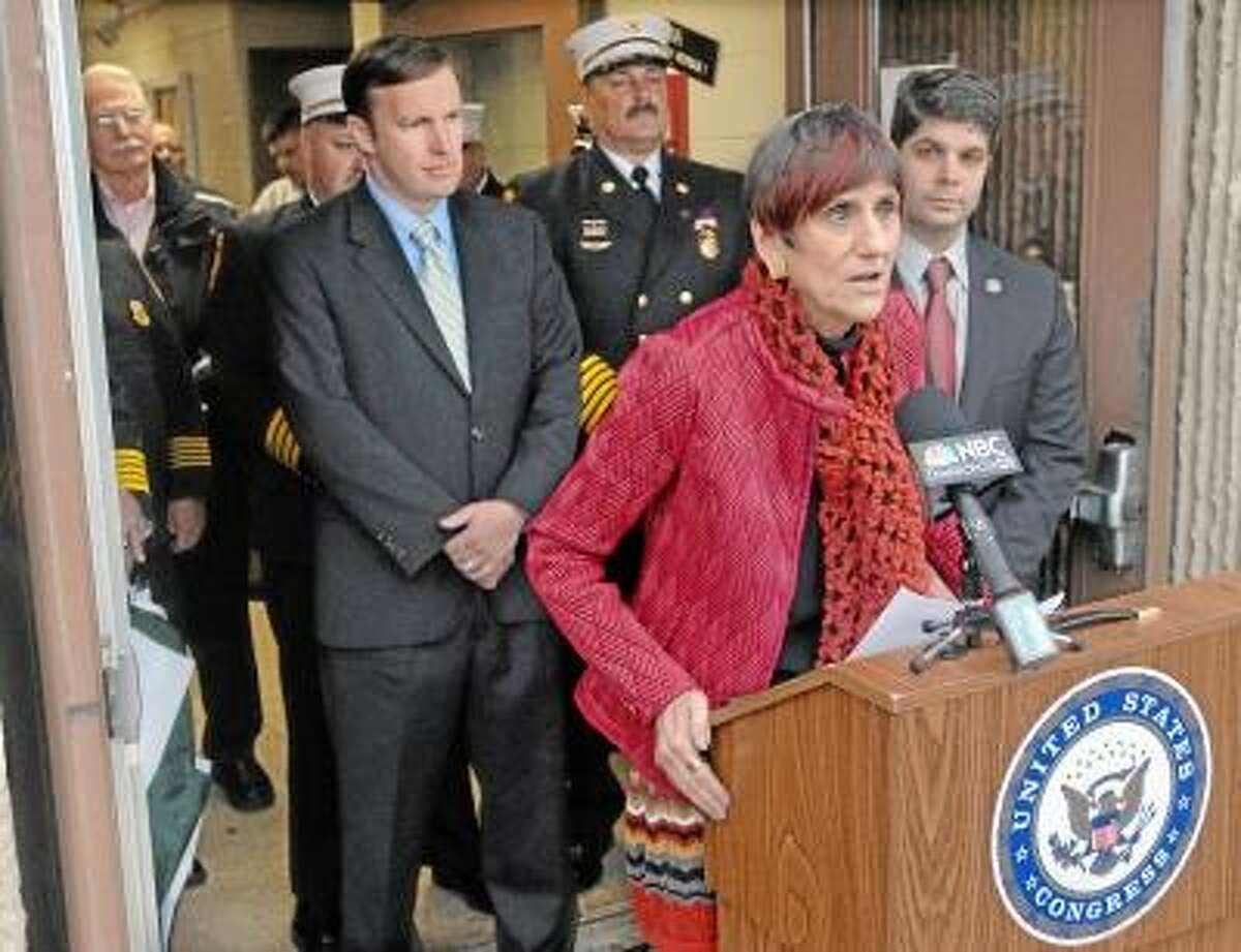 Catherine Avalone/The Middletown Press U.S Rep. Rosa DeLauro, D-3, speaks at a press conference in Middletown at the U.S. Army Reserve Center on Mile Lane Monday afternoon announcing that the property now belongs to the city of Middletown and will be used as a regional fire training facility. In the background is U.S. Sen.-elect Chris Murphy, Middletown Deputy Fire Chief Rob Kronenberger, Middletown Fire Chief Gary Oulette and Mayor Dan Drew.