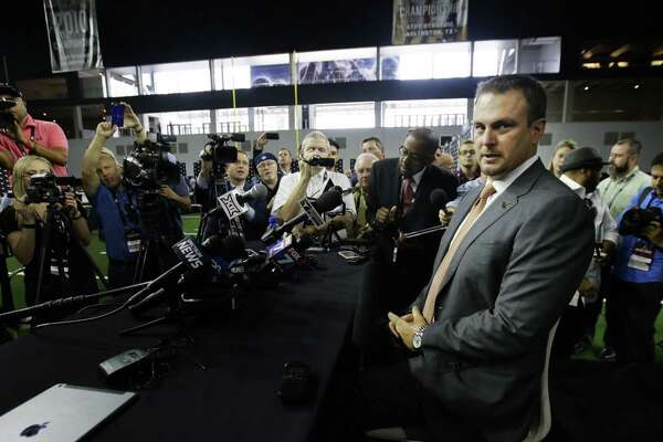 Texas coach Tom Herman takes a seat before speaking to reporters during the Big 12 media days in Frisc on July 18, 2017.